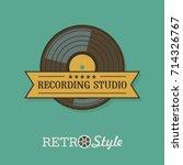 the vinyl record. vector emblem.... | Shutterstock .eps vector #714326767