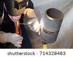 welder testing welding at... | Shutterstock . vector #714328483