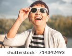 mature attractive woman 50... | Shutterstock . vector #714342493