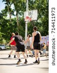 Small photo of Komsomolsk-on-Amur, Russia, August 1, 2015. young men play amateur basketball in summer