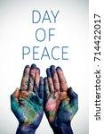 Small photo of the hands of a young man put together patterned with a world map (furnished by NASA) and the text day of peace, with a slight vignette added