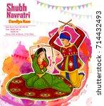 couple performing garba dance... | Shutterstock .eps vector #714432493