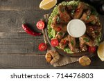 barbecue grilled chicken wings... | Shutterstock . vector #714476803