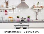 interior of a light kitchen in... | Shutterstock . vector #714495193
