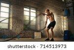 muscular shirtless man in a gym ... | Shutterstock . vector #714513973