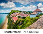 bright view of old town piran.... | Shutterstock . vector #714530353