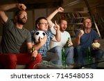four friends watching football... | Shutterstock . vector #714548053