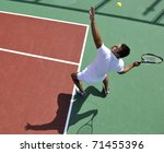 Young Man Play Tennis Outdoor...