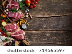 raw meat  wine  ingredients and ... | Shutterstock . vector #714565597