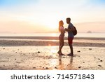 couple on beach at sunset... | Shutterstock . vector #714571843