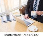smiling handsome worker... | Shutterstock . vector #714573127