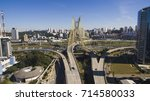cable stayed bridge across the... | Shutterstock . vector #714580033
