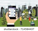 human hand holds smart phone... | Shutterstock .eps vector #714584437