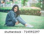 teenage girl sitting in the... | Shutterstock . vector #714592297