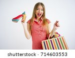 pretty girl with shopping bags | Shutterstock . vector #714603553