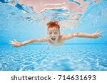 happy young boy swim and dive... | Shutterstock . vector #714631693