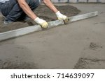 pouring concrete slab | Shutterstock . vector #714639097