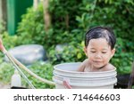 children play and bathed water... | Shutterstock . vector #714646603