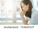 asian woman praying with bible... | Shutterstock . vector #714665137