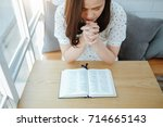 asian woman praying with bible... | Shutterstock . vector #714665143