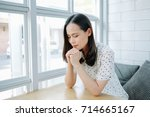 asian woman praying with bible... | Shutterstock . vector #714665167