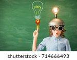 smart kid in classroom. child... | Shutterstock . vector #714666493