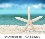 starfish on the summer beach... | Shutterstock . vector #714685237