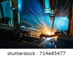robots welding machine in a car ... | Shutterstock . vector #714685477