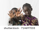 two african children making... | Shutterstock . vector #714697033