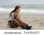 alone sad woman sitting on a... | Shutterstock . vector #714701377