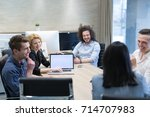 group of a young business... | Shutterstock . vector #714707983