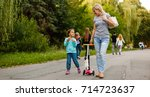 mother and daughter walking... | Shutterstock . vector #714723637