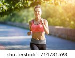 young smiling sporty woman... | Shutterstock . vector #714731593