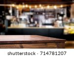 empty brown wooden table and... | Shutterstock . vector #714781207