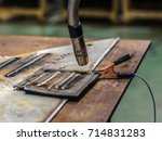 close up welding robots nozzle... | Shutterstock . vector #714831283