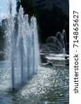 Small photo of Summer Sultry landscape. Fountain with water in the park