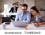 coworkers working on project... | Shutterstock . vector #714882643