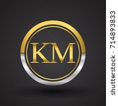 km letter logo in a circle ... | Shutterstock .eps vector #714893833