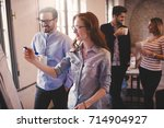group of creative designers and ... | Shutterstock . vector #714904927