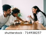 happy family playing chess... | Shutterstock . vector #714938257