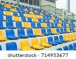 sport stadium plastic chairs in ... | Shutterstock . vector #714953677