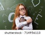 schoolgirl in the classroom.   Shutterstock . vector #714956113
