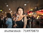 young brunette tattooed woman... | Shutterstock . vector #714970873