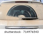 dirty car in dust view of...   Shutterstock . vector #714976543