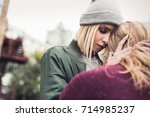 beautiful young woman embracing ... | Shutterstock . vector #714985237