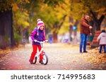 cute happy girl riding a bike...   Shutterstock . vector #714995683