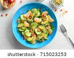 superfood salad with avocado ... | Shutterstock . vector #715023253