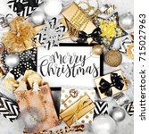 merry christmas card with black ...   Shutterstock . vector #715027963