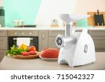 meat grinder with fresh meat on ... | Shutterstock . vector #715042327