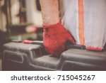 senior man in workshop. man... | Shutterstock . vector #715045267